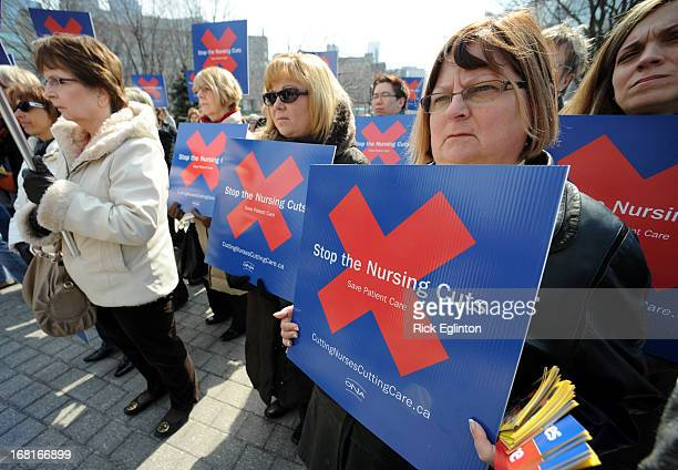 Approximately 150 Placard waving registered nurses allied health professionals and students members of the Ontario Nurses Association march on...