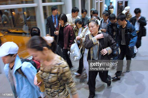 Approximately twenty North Korean asylum seekers arrive at Incheon International Airport October 12 2002 from China via Philippines west of Seoul...