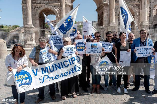Approximately twenty supporters of the 'Noi Con Salvini' party attend a demonstration at the Colosseum on June 9 2017 in Rome Italy The group were...