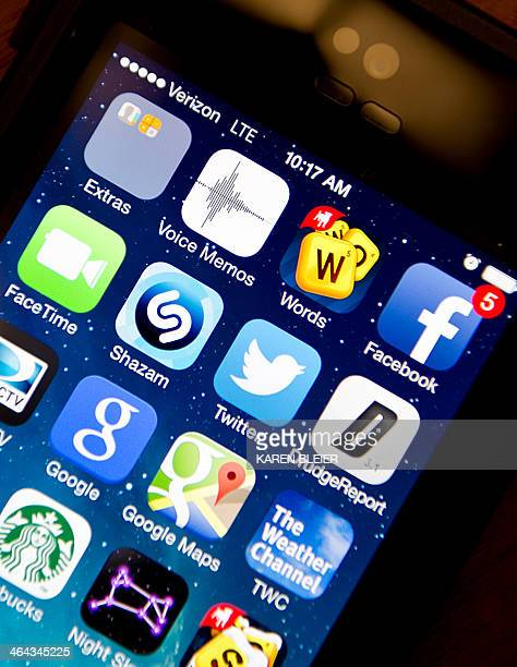 Apps are seen on Apple iPhone 5s January 22 2014 in Washington DC AFP PHOTO/Karen BLEIER