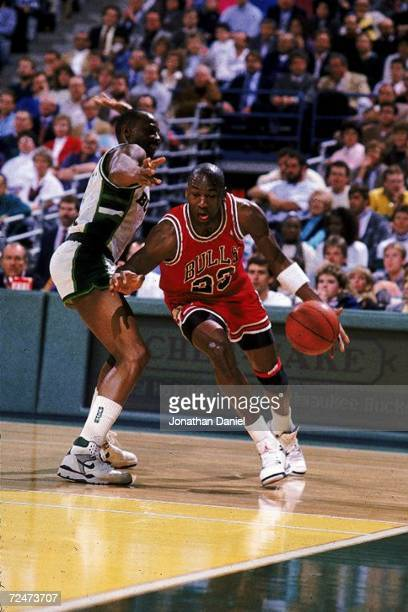 Michael Jordan of the Chicago Bulls moves with the ball during the game against the Milwaukee Bucks Mandatory Credit Jonathan Daniel /Allsport