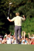Jack Nicklaus of the USA holes a birdie putt on the 17th hole of the final round on his way to victory in the US Masters at Augusta National in...