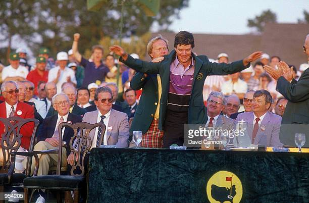 Jack Nicklaus of the USA presents Larry Mize of the USA with his green jacket after the thrilling US Masters 1987 second playoff hole held at the...