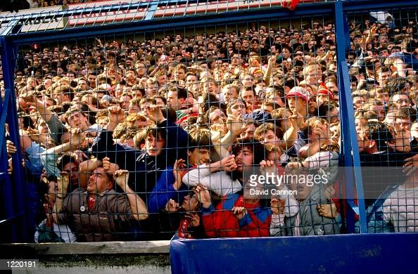 Supporters are crushed against the barrier as disaster strikes before the FA Cup semifinal match between Liverpool and Nottingham Forest played at...