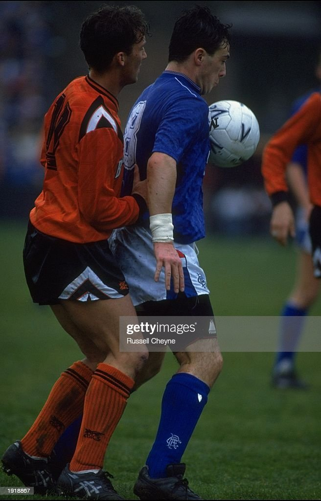 Derek Ferguson (right) of Rangers is shadowed by Billy McKinlay (left) of Dundee United during the Scottish Premier Division match at Ibrox Park in Glasgow, Scotland. Rangers won the match 1-0. \ Mandatory Credit: Russell Cheyne/Allsport
