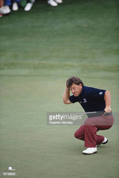 Ian Woosnam of Wales punches the air in triumph as he watches his winning putt on the 18th green during the US Masters at Augusta in Georgia USA...