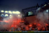 Juventus fans celebrate their team's victory by lighting flares after the Cup Winners Cup SemiFinal match against Barcelona at the Delle Alpi Stadium...
