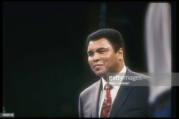 Muhammad Ali looks on during a bout between Evander Holyfield and George Foreman at Caesar''s Palace in Las Vegas Nevada Mandatory Credit Barry...