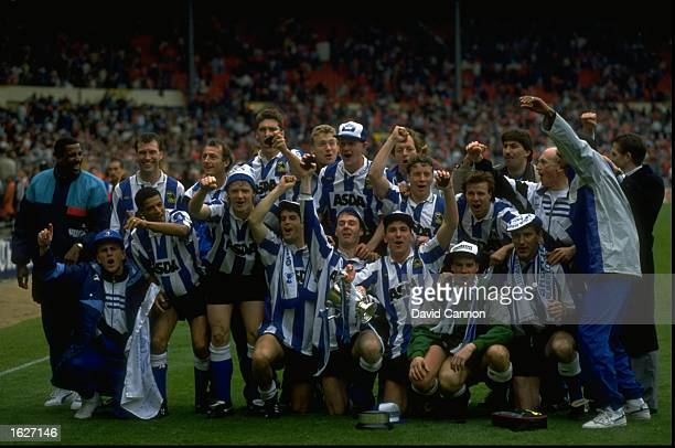 The Sheffield Wednesday team celebrate after their win in the League Cup Final match against Manchester United at Wembley Stadium in Wembley London...