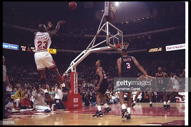 Guard Michael Jordan of the Chicago Bulls takes a shot during a first round playoff game against the Miami Heat at the United Center in Chicago...