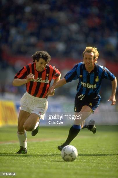Roberto Donadoni of AC Milan takes on Andreas Brehme of Inter Milan during a Series A match at the San Siro Stadium in Milan Italy AC Milan won the...