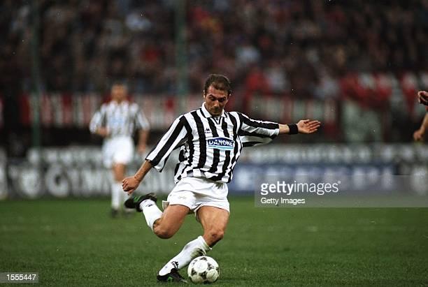 Antonio Conte of Juventus in action during a Series A match against AC Milan at the San Siro Stadium in Milan Italy Juventus won the match 20...