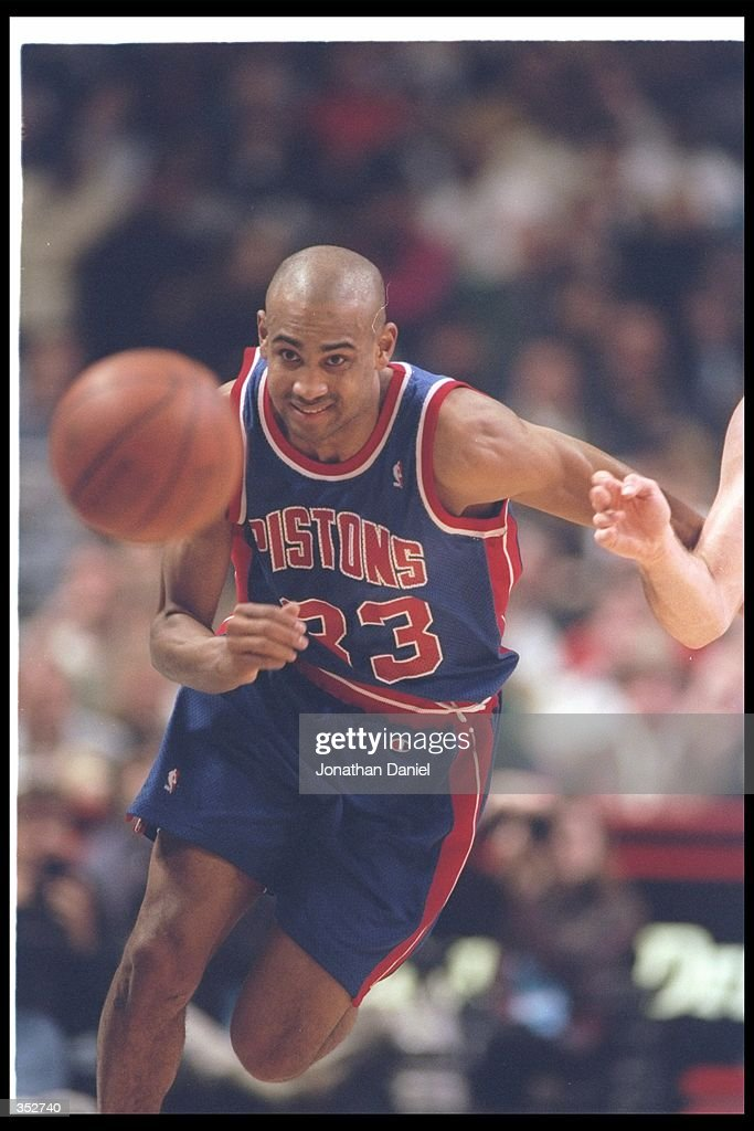 Forward Grant Hill of the Detroit Pistons moves down the court during a game against the Chicago Bulls at the United Center in Chicago Illinois...