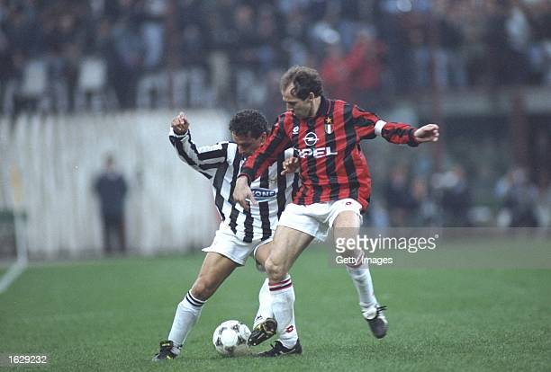 Robertio Baggio of Juventus takes on Franco Baresi of AC Milan during a Serie A match at the San Siro Stadium in Milan Italy Juventus won the match...