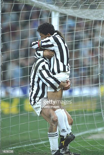 Roberto Baggio of Juventus FC celebrates with a team mate during the UEFA Cup semifinal against Borussia Dortmund at the Delle Alpi Stadium in Turin...