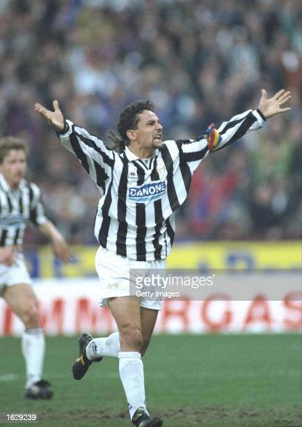 Roberto Baggio of Juventus FC holds his arms aloft in celebration during the UEFA Cup semifinal against Borussia Dortmund at the Delle Alpi Stadium...