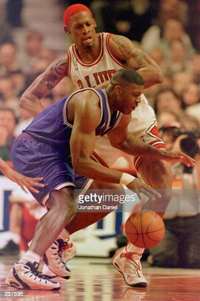 Charlotte Hornets forward Larry Johnson tries to drive around Chicago Bulls forward Dennis Rodman at the United Center in Chicago Illinois Mandatory...