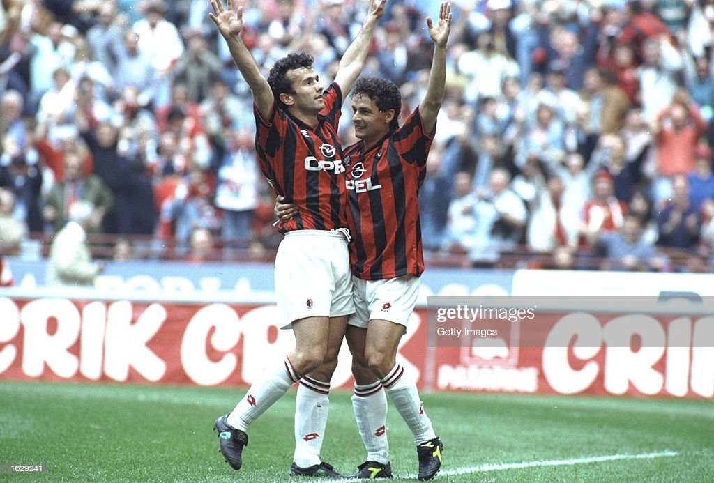 Dejan Savicevic and Robertio Baggio both of AC Milan celebrate after their team wins the Serie A Scudetta in Milan, Italy. \ Mandatory Credit: Allsport UK /Allsport