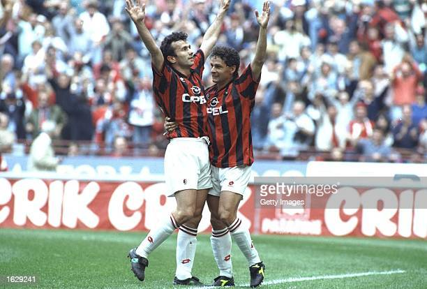 Dejan Savicevic and Robertio Baggio both of AC Milan celebrate after their team wins the Serie A Scudetta in Milan Italy Mandatory Credit Allsport UK...
