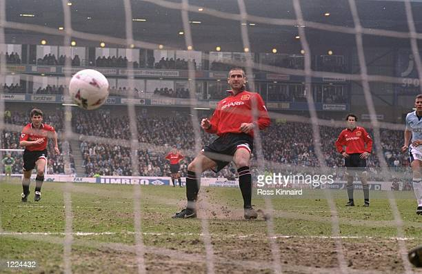 Eric Cantona of Manchester United scores a penalty during an FA Carling Premiership match against Manchester City at Maine Road in Manchester England...