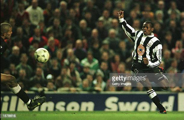 Faustino Asprilla of Newcastle scores the third goal past Liverpool goalkeeper David James during their FA Premiership game at Anfieldon April 3 1996...