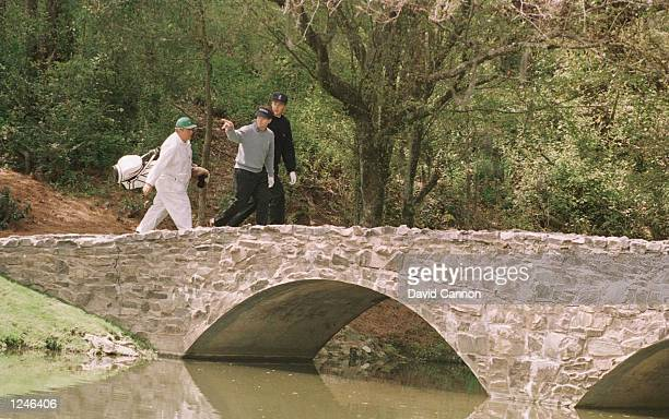 Gordon Sherry of Scotland along with playing partner Tom Watson of the USA cross over the bridge between the 13th tee and the 13th fairway during...