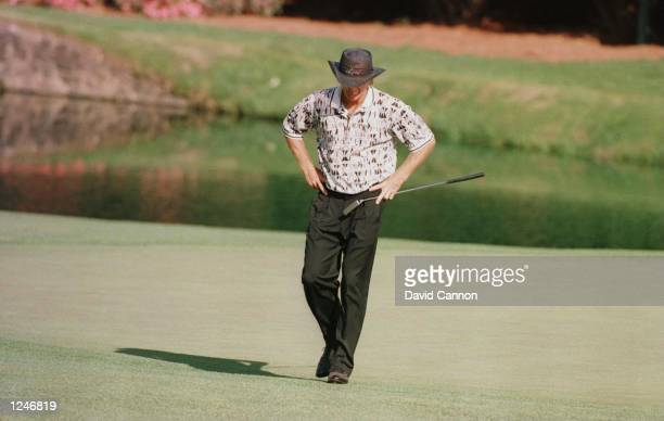 Greg Norman of Australia looks to the ground in dejection after missing another putt during the final round of the 1996 Masters at Augusta National...