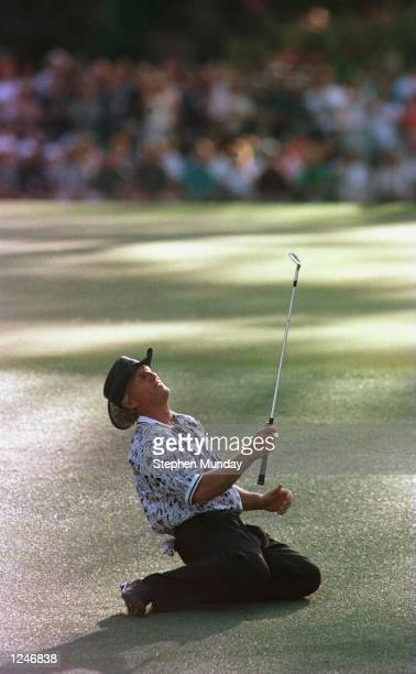 Greg Norman of Australia sinks to his knees in frustration after narrowly missing the hole with his chip shot on the 15th during the final round of...