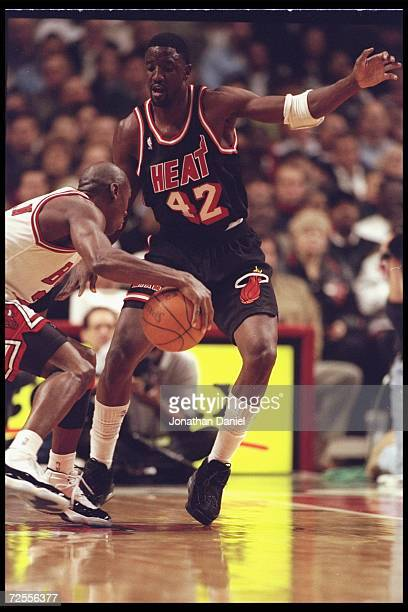 Guard Michael Jordan of the Chicago Bulls and Walt Williams of the Miami Heat fight for the ball during a game played at the United Center in Chicago...