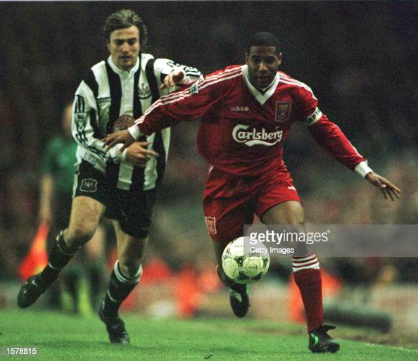 John Barnes of Liverpool battles for the ball with David Ginola of Newcastle United during their FA Premiership game at Anfield Liverpool Mandatory...