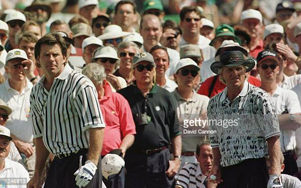 Nick Faldo of England and Greg Norman of Australia stand together on the third tee during the final round of the 1996 Masters at Augusta National...