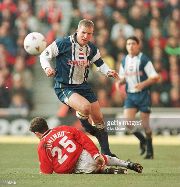 Peter Atherton of Sheffield Wednesday takes the ball as Juninho of Middlesbrough is left on the ground during their FA Carling Premiership game at...