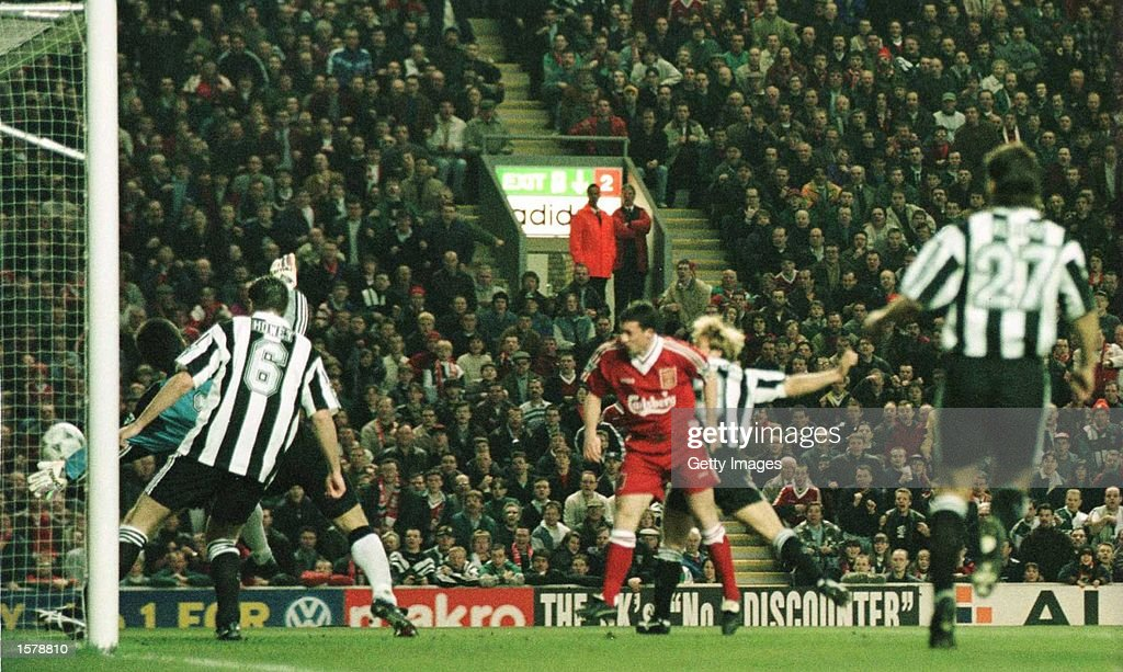 Robbie Fowler of Liverpool heads to score against Newcastle United in the first two minutes of their FA Premiership game at Anfield in Liverpool, England. Mandatory Credit: Allsport UK/Allsport