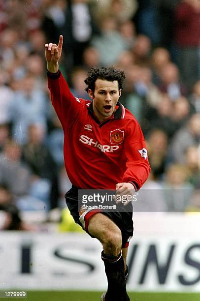 Ryan Giggs of Manchester United celebrates during an FA Carling Premiership match against Manchester City at Maine Road in Manchester England...