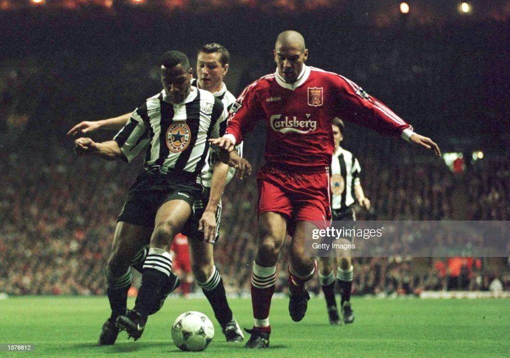 Stan Collymore of Liverpool battles for the ball with Les Ferdinand of Newcastle United during their FA Premiership game at Anfield Liverpool...