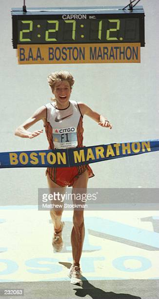Uta Pippig of Germany crosses the finish line in 22712 to win the women''s division of the 100th runnning of the Boston Marathon Boston Massachusetts...