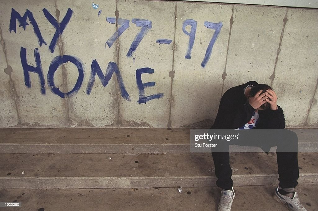 A dejected Brighton fan holds his head in his hands after Brighton's last game at The Goldstone ground. Brighton beat Doncaster Rovers 1-0. \ Mandatory Credit: Stu Forster /Allsport