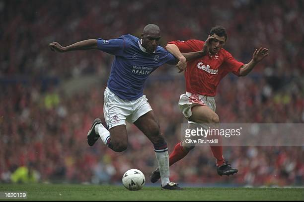 Andy Morris of Chesterfield holds off Gianluca Festa of Middlesbrough in the FA Cup SemiFinal at Old Trafford in Manchester England The game was...