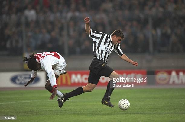 Christian Vieri of Juventus comes away with the ball after a challenge by Mario Melchiot of Ajax during the Champions League SemiFinal second leg at...
