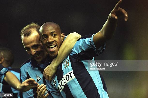 Dion Dublin of Coventry City celebrates during an FA Carling Premiership match against Arsenal at the Highfield Road Stadium in Coventry England...