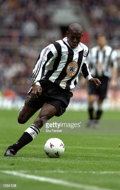 Faustino Asprilla of Newcastle United in action during an FA Carling Premiership match against Derby County at St James'' Park in Newcastle England...