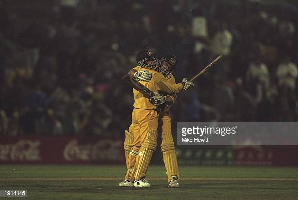 Ian Healy and Adam Gilchrist of Australia celebrate after winning the sixth One Day International against South Africa at Centurion Park in Centurion...
