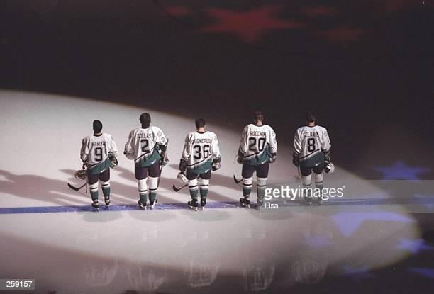 Members of the starting lineup including defensemen Bobby Dollas left wing Paul Kariya and right wing Teemu Selanne of the Anaheim Mighty Ducks...