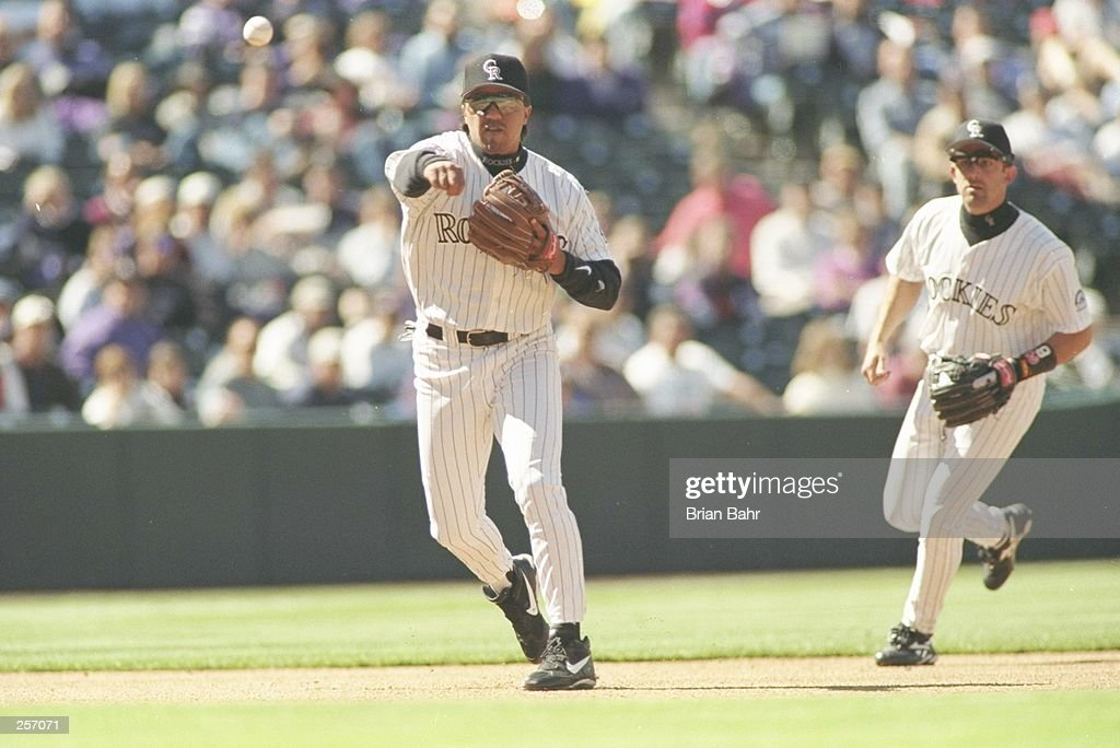 Third baseman Vinny Castilla of the Colorado Rockies throws the ball during a game against the Montreal Expos at Coors Field in Denver Colorado The...
