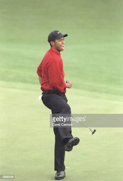 Tiger Woods celebrates afer making a par putt to win the Masters Tournament at the Augusta National Golf Course in Augusta Georgia Mandatory Credit...