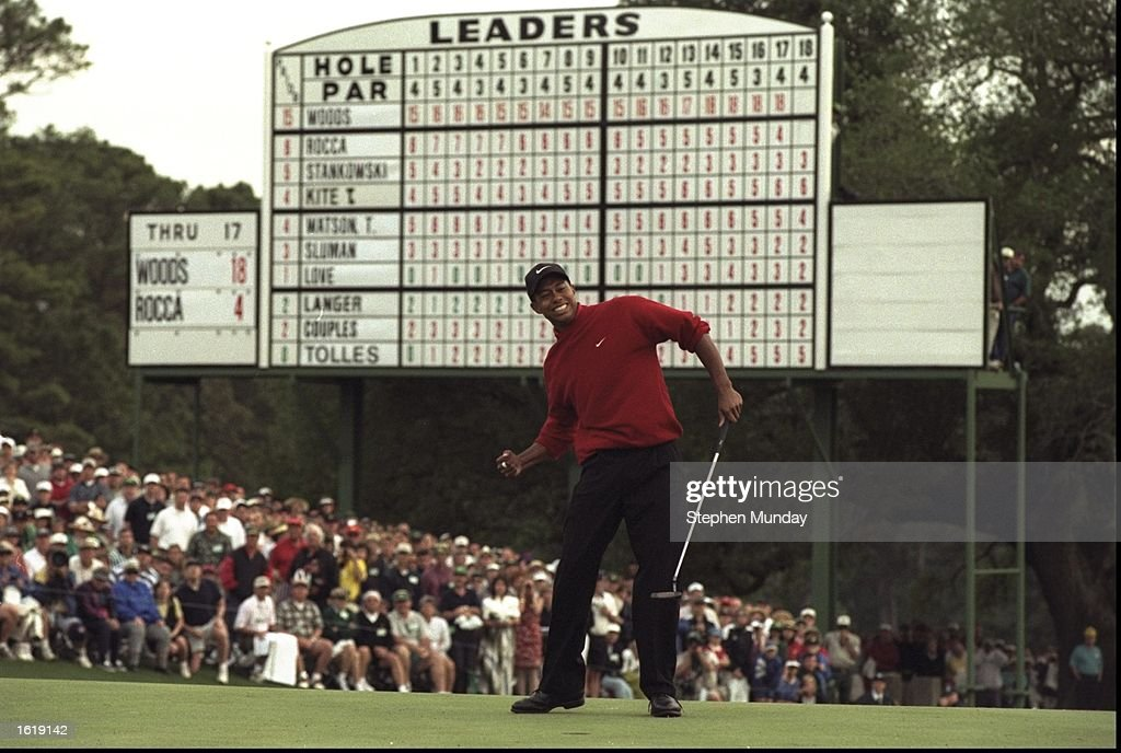 Tiger Woods of the USA celebrates after sinking a 4 feet putt to win the US Masters at Augusta Georgia Woods won the tournament with a record low...