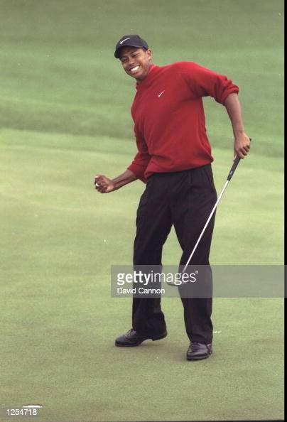 Tiger Woods of the USA celebrates victory in the US Masters at Augusta Georgia Woods won the tournament with a record low score of 18 under par...