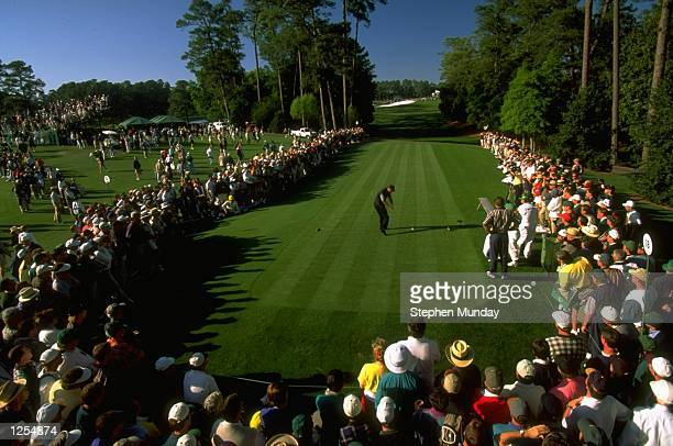 Tiger Woods of the USA tees off at the 18th during the first day of the US Masters at Augusta Georgia Woods went on to win the tournament with a...