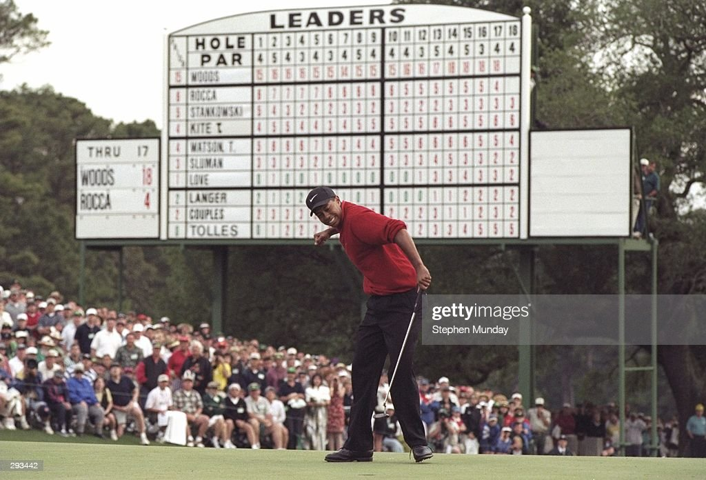 Tigers Woods hits a four foot putt on the 18th hole to win the Masters Tournament at the Augusta National Golf Course in Augusta Georgia Mandatory...