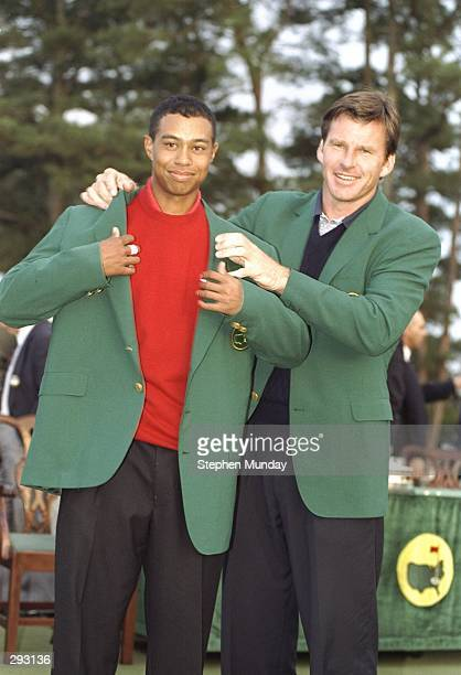 Tigers Woods receives his green jacket from Nick Faldo at the Masters Tournament at the Augusta National Golf Course in Augusta Georgia Mandatory...
